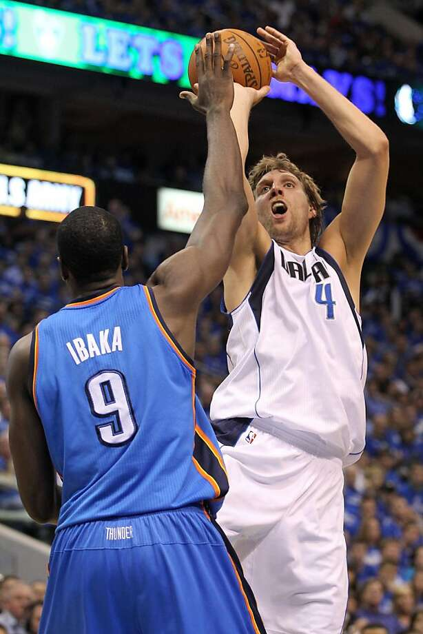 DALLAS, TX - MAY 17:  Dirk Nowitzki #41 of the Dallas Mavericks shoots over Serge Ibaka #9 of the Oklahoma City Thunder in the second quarter in Game One of the Western Conference Finals during the 2011 NBA Playoffs at American Airlines Center on May 17,2011 in Dallas, Texas. NOTE TO USER: User expressly acknowledges and agrees that, by downloading and or using this photograph, User is consenting to the terms and conditions of the Getty Images License Agreement. Photo: Ronald Martinez, Getty Images