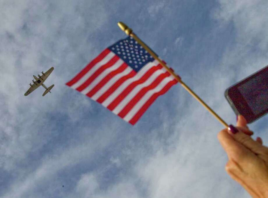 A B-17 bomber flies by a Pearl Harbor memorial service on the 70th anniversary of the attacks Wednesday, Dec. 7, 2011 in Phoenix. Photo: Matt York, Associated Press / AP