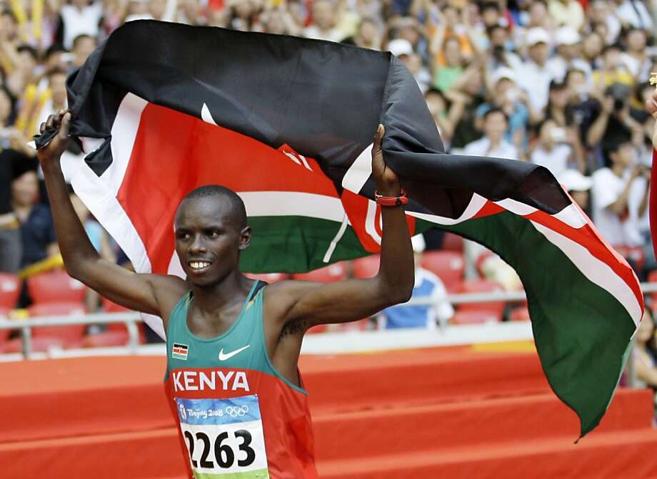 FILE -- In a Aug. 24, 2008 file photo, Kenya's Sammy Kamau Wanjiru celebrates winning the gold during the men's marathon at the Beijing 2008 Olympics in Beijing.  Wanjiru died in Kenya early Monday, May 16, 2011, after jumping from a balcony, police said. Photo: David J. Phillip, AP