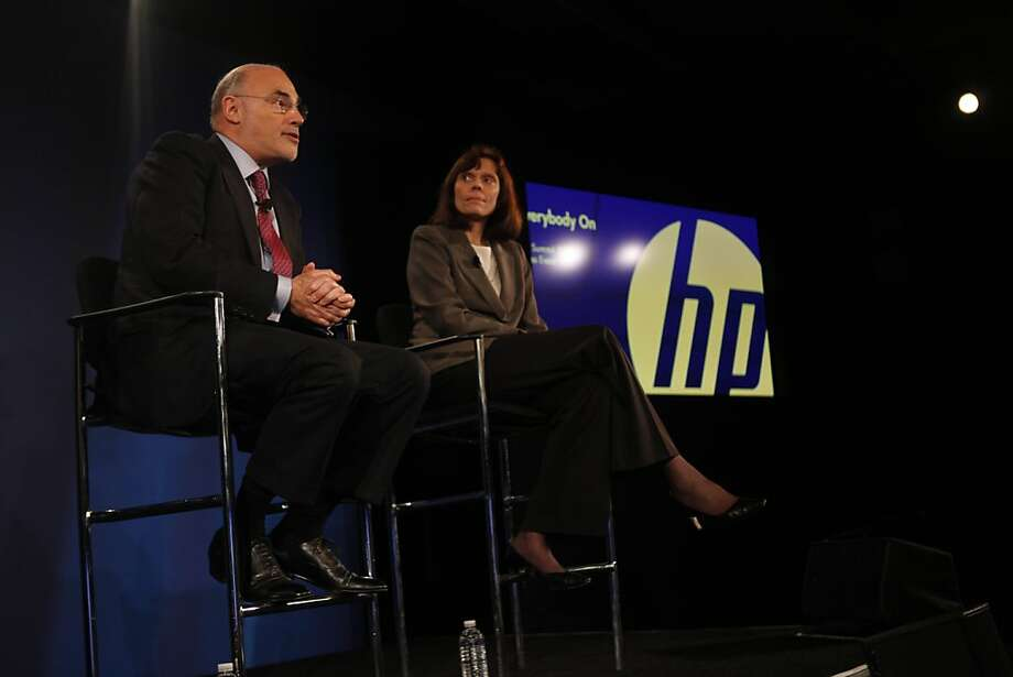 Hewlett Packard Co. Chief Executive Officer LŽo Apotheker (l to r) answers a question during a press conference as Cathie Lesjak, Chief Financial Officer and Executive Vice President of Hewlett Packard Co. listens on Monday, March 14, 2011 in San Francisco, Calif. Photo: Lea Suzuki, The Chronicle