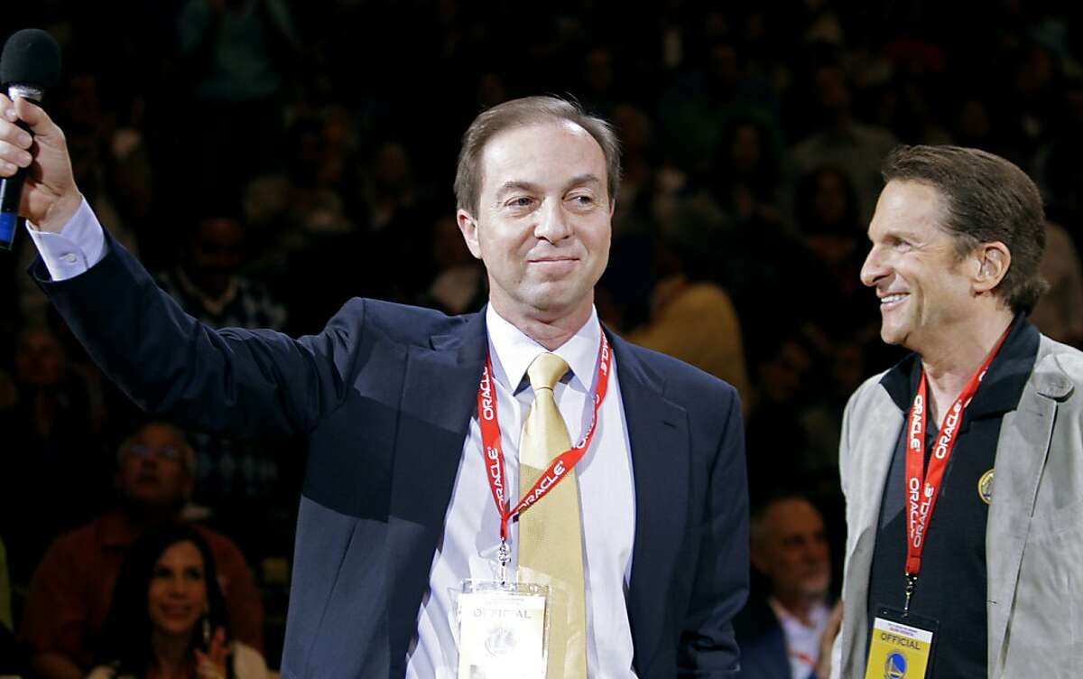 The Golden State Warriors' new owners Joe Lacob, left, and Peter Guber, right, stand at the Warriors' NBA basketball game against the Detroit Pistons on Monday, Nov. 15, 2010, in Oakland, Calif.