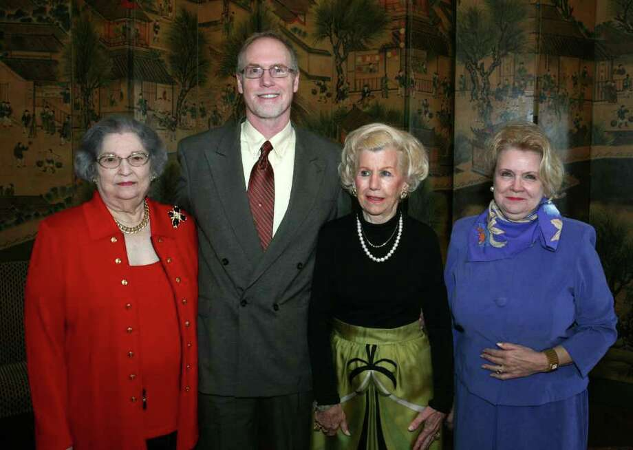 """Event chairwoman Bebe Inkley (from left), honoree William McCrary, President Francine Rowden and vice chairwoman Carolyn Sanders gather during """"Romance Is in the Air,"""" the Opera Guild of San Antonio's fundraising luncheon at the San Antonio Country Club. Photo: For The Express-News, Leland A. Outz / SAN ANTONIO EXPRESS-NEWS"""