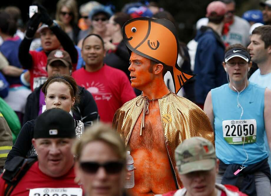 Even when you're all orange, you don't seem out of place at the Bay to Breakers. The 100th running of the Bay to Breakers race in San Francisco, Calif. featured thousands of people and a few new rules to tame past turmoil Sunday May 16, 2011. Photo: Brant Ward, The Chronicle