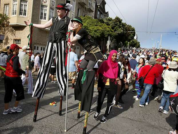 As if the hill wasn't tough enough, this couple scaled it on stilts. The 100th running of the Bay to Breakers race in San Francisco, Calif. featured thousands of people and a few new rules to tame past turmoil Sunday May 16, 2011. Photo: Brant Ward, The Chronicle