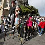 As if the hill wasn't tough enough, this couple scaled it on stilts. The 100th running of the Bay to Breakers race in San Francisco, Calif. featured thousands of people and a few new rules to tame past turmoil Sunday May 16, 2011.