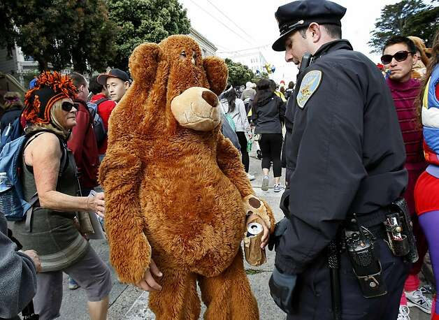 Officer Mike Horan confronted a teddy bear with a bear and told him to throw it out. The 100th running of the Bay to Breakers race in San Francisco, Calif. featured thousands of people and a few new rules to tame past turmoil Sunday May 16, 2011. Photo: Brant Ward, The Chronicle