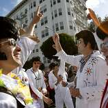 The Elvises met at the top of the Hayes Street hill. The 100th running of the Bay to Breakers race in San Francisco, Calif. featured thousands of people and a few new rules to tame past turmoil Sunday May 16, 2011.