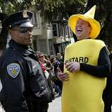 Officer Wilson checked out the contents of Mr. Mustard. The 100th running of the Bay to Breakers race in San Francisco, Calif. featured thousands of people and a few new rules to tame past turmoil Sunday May 16, 2011.