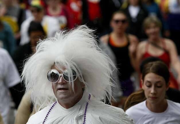 An Elton John creation joined the race. The 100th running of the Bay to Breakers race in San Francisco, Calif. featured thousands of people and a few new rules to tame past turmoil Sunday May 16, 2011. Photo: Brant Ward, The Chronicle