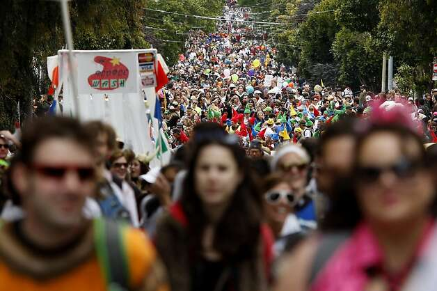 Thousands made their way up Hayes Street, the steepest part of the race. The 100th running of the Bay to Breakers race in San Francisco, Calif. featured thousands of people and a few new rules to tame past turmoil Sunday May 16, 2011. Photo: Brant Ward, The Chronicle