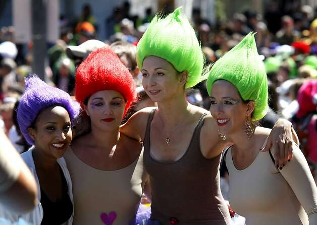 These lady runners obviously use the same hair dresser. The 100th running of the Bay to Breakers race in San Francisco, Calif. featured thousands of people and a few new rules to tame past turmoil Sunday May 16, 2011. Photo: Brant Ward, The Chronicle