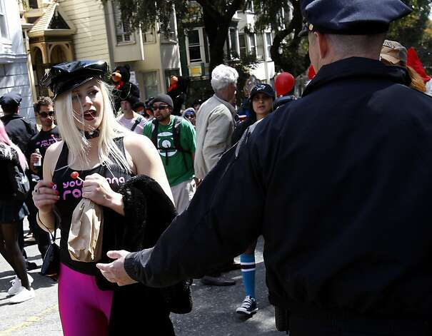 A woman was reluctant to give up her unopened bottle of liquor. The 100th running of the Bay to Breakers race in San Francisco, Calif. featured thousands of people and a few new rules to tame past turmoil Sunday May 16, 2011. Photo: Brant Ward, The Chronicle