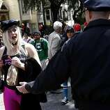 A woman was reluctant to give up her unopened bottle of liquor. The 100th running of the Bay to Breakers race in San Francisco, Calif. featured thousands of people and a few new rules to tame past turmoil Sunday May 16, 2011.