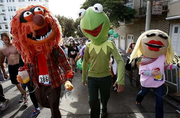 Friends from Sesame Street walked the last part of the steep Hayes Street portion of the race. The 100th running of the Bay to Breakers race in San Francisco, Calif. featured thousands of people and a few new rules to tame past turmoil Sunday May 16, 2011. Photo: Brant Ward, The Chronicle