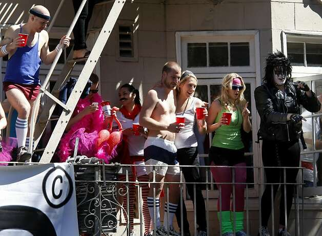 Parties on Hayes Street made for crowded balconies and fire escapes. The 100th running of the Bay to Breakers race in San Francisco, Calif. featured thousands of people and a few new rules to tame past turmoil Sunday May 16, 2011. Photo: Brant Ward, The Chronicle