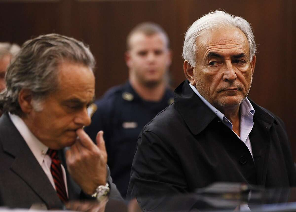 Dominique Strauss-Kahn, right, head of the International Monetary Fund, with his attorney Benjamin Brafman, is arraigned Monday, May 16, 2011, in Manhattan Criminal Court for the alleged attack Saturday on a maid who went into his penthouse suite at a hotel near Times Square to clean it, in New York. Strauss-Kahn must remain jailed at least until his next court hearing for attempted rape and other charges, a judge said Monday.