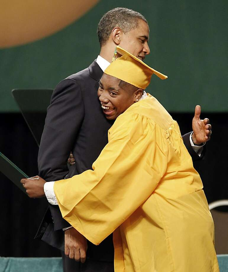 President Barack Obama gets a hug from a student as diplomas are presented at the commencement ceremony for Booker T. Washington High School on Monday, May 16, 2011, in Memphis, Tenn. After the school administration implemented educational changes, the graduation rate jumped from 55 percent in 2007 to nearly 82 percent in 2010. Photo: Mark Humphrey, AP