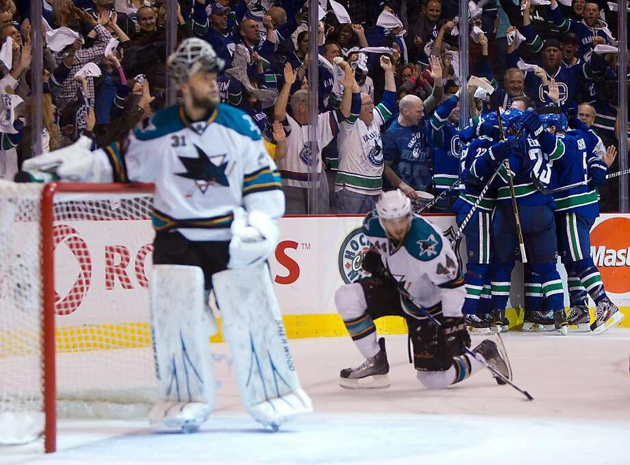 San Jose Sharks' Antti Niemi (31) of Finland, and Marc-Edouard Vlasic look on as Vancouver Canucks' Daniel Sedin, of Sweden, Henrik Sedin, of Sweden, Alexander Edler, of Sweden, Ryan Kesler and Christian Ehrhoff, of Germany, celebrate Henrik Sedin's game-winning goal during the third period.  in Game 1 of an NHL hockey Stanley Cup Western Conference final playoff series, Sunday, May 15, 2011, in Vancouver, Canada. Photo: Darryl Dyck, AP