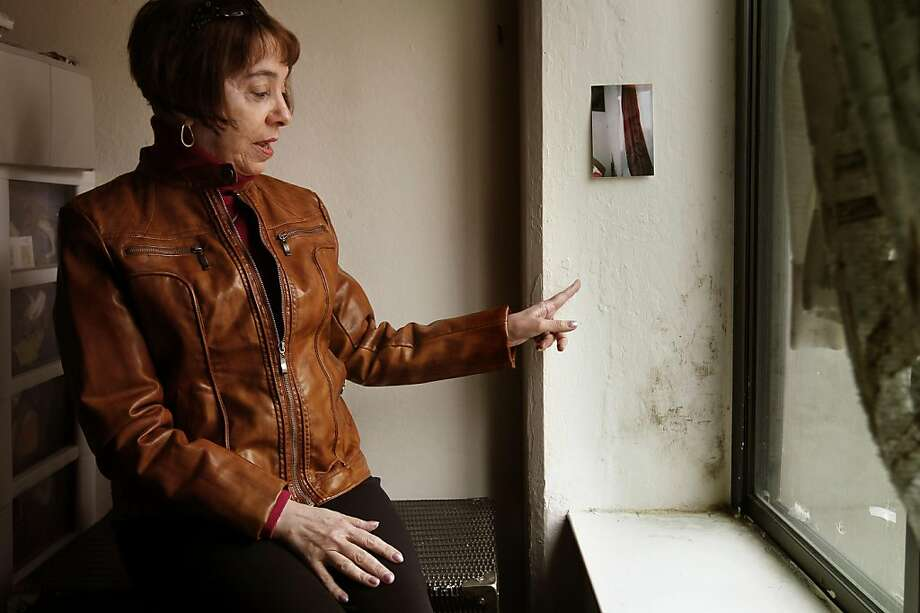 Marie DePirro, on Wednesday May 11, 2011, shows the wall along her bedroom window with mold growing inside her San Francisco, Ca. apartment.  60-year-old DePirro lives in subsidized housing which she says has mold and ventilation problems that may not be terrible for the average person but she has a series of autoimmune diseases as well as respiratory troubles. She wants to move out but her housing subsidy is tied to the building, not to her. Photo: Michael Macor, The Chronicle
