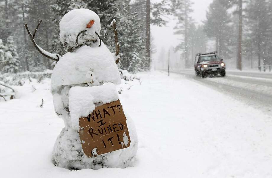 SOUTH LAKE TAHOE, CA - MAY 15:  A snowman holds a sign along the race route on Highway 89 after stage one of the 2011 AMGEN Tour of California from South Lake Tahoe to North Lake Tahoe was cancelled due to unsafe conditions caused by snow on May 15, 2011in South Lake Tahoe, California. Photo: Doug Pensinger, Getty Images