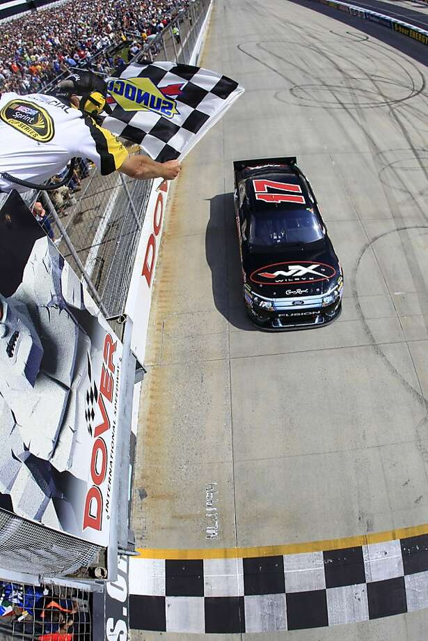 Matt Kenseth takes the checkered flag to win the NASCAR Sprint Cup Series auto race at Dover International Speedway on Sunday, May 15, 2011, in Dover, Del. Photo: Chris Trotman, AP