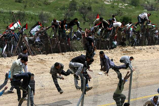 MAJDAL SHAMS, ISRAEL - MAY 15:  (ISRAEL OUT) Palestinian protesters infiltrate the Israel-Syria border on May 15, 2011 near the Druze village of Majdal Shams, Israel. Reportedly at least twelve were killed and several injured when IDF soldiers open fired on protesters attempting to cross the Syria-Israel border adjacent to Majdal Shams in northern Israel. Palestinians today were remonstrating the establishment of Israel in 1948, termed 'Nakba Day.' (Photo by Jalaa Marey/JINI/Getty Images) *** BESTPIX *** Photo: Getty Images