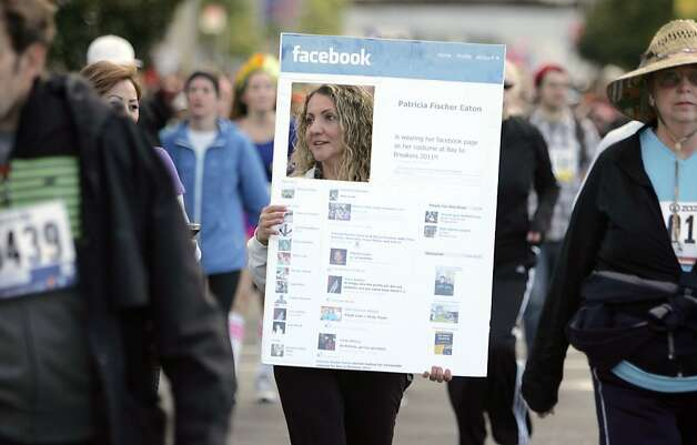 Patricia Fischer Eaton wears her Facebook page on Howard  Street during the 100th annual Bay to Breakers race in San Francisco, Calif., on Sunday, May 15, 2011. Photo: Douglas Zimmerman, Courtesy To The SF Gate