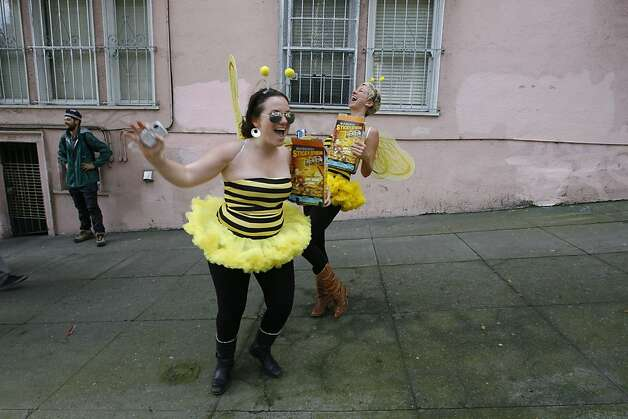 Two participants dressed up as bumble bees dance on Hayes Street during the 2011 Bay to Breakers in San Francisco on Sunday, May 15, 2011. Photo: Douglas Zimmerman, Courtesy To The SF Gate