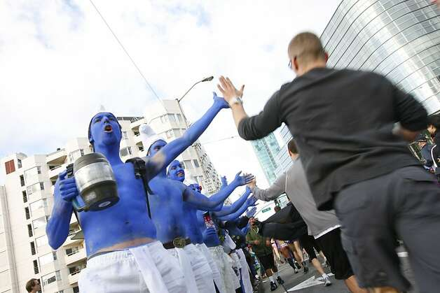A group of smurfs cheer and hi-five runners on Howard Street during the 100th annual Bay to Breakers race in San Francisco, Calif., on Sunday, May 15, 2011. Photo: Douglas Zimmerman, Courtesy To The SF Gate