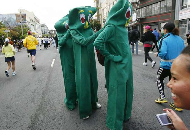 A Gumby helps another Gumby adjust it's suit on Howard Street during the 100th annual Bay to Breakers race in San Francisco, Calif., on Sunday, May 15, 2011. Photo: Douglas Zimmerman, Courtesy To The SF Gate
