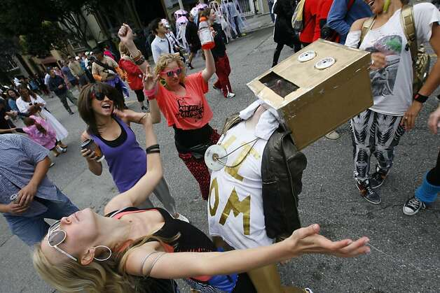 People dance  on Hayes Street during the 2011 Bay to Breakers in San Francisco on Sunday, May 15, 2011. Photo: Douglas Zimmerman, Courtesy To The SF Gate