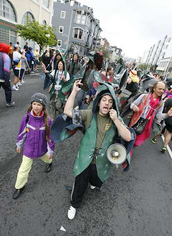 A group of spawning salmon walk against the steam of runners on Howard Street during the 2011 Bay to Breakers in San Francisco on Sunday, May 15, 2011. Photo: Douglas Zimmerman, Courtesy To The SF Gate