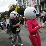 A Mr. and Mrs. Jack in the Box run on Hayes Street during the 100th annual Bay to Breakers race in San Francisco, Calif., on Sunday, May 15, 2011.