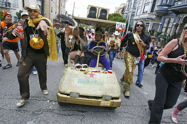 A golf cart makes its way through the crowd Hayes Street during the 2011 Bay to Breakers in San Francisco on Sunday, May 15, 2011. Photo: Douglas Zimmerman, Courtesy To The SF Gate
