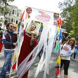 "A customer emerges for a ""People Wash"" on Fell Street during the 100th annual Bay to Breakers race in San Francisco, Calif., on Sunday, May 15, 2011."