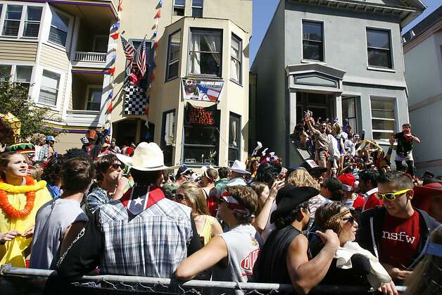 People hang out on their front stoops on Fell Street during the 100th annual Bay to Breakers race in San Francisco, Calif., on Sunday, May 15, 2011. Photo: Douglas Zimmerman, Courtesy To The SF Gate