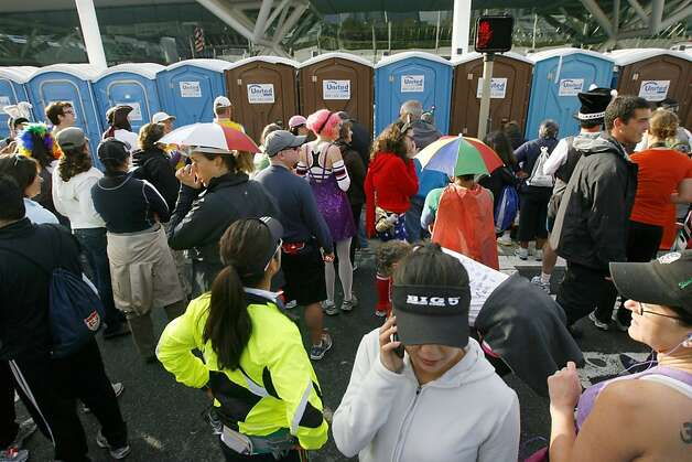 People wait to use the port-o-poties on Howard Street during the 2011 Bay to Breakers in San Francisco on Sunday, May 15, 2011. Photo: Douglas Zimmerman, Courtesy To The SF Gate