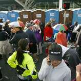 People wait to use the port-o-poties on Howard Street during the 2011 Bay to Breakers in San Francisco on Sunday, May 15, 2011.