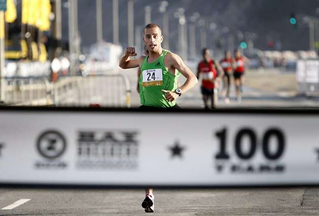 Ridouane Harroufi of Morocco is the first man to cross the finish in 34 minutes 26 seconds during the 100th annual Bay to Breakers 12K in San Francisco, Calif., on Sunday, May 15, 2011. Photo: Thomas Levinson, The Chronicle