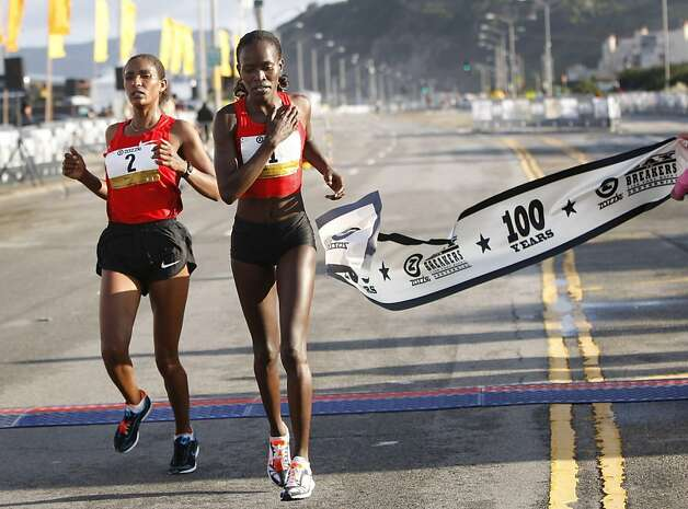 Lineth Chepkurui of Kenya is the first woman to cross the finish in 39 minutes 12 seconds, with Mamitu Daska of Ethiopia right behind during the 100th annual Bay to Breakers 12K in San Francisco, Calif., on Sunday, May 15, 2011. Photo: Thomas Levinson, The Chronicle