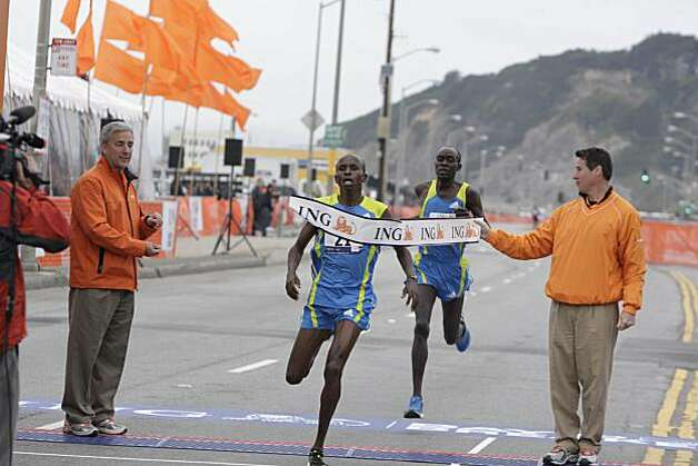 Sammy Kitwara (second from left), defending Bay to Breakers champion, of Kenya, finishes before Peter Kirui (second from right) of Kenya in the Bay to Breakers in San Francisco, Calif. on Sunday May 16, 2010. Photo: Lea Suzuki, The Chronicle