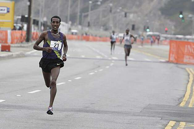 Tilahun Regassa of Ethiopia, who finished third, races down the Great Highway in the 2010 Bay to Breakers in San Francisco, Calif. on Sunday May 16, 2010. Photo: Lea Suzuki, The Chronicle