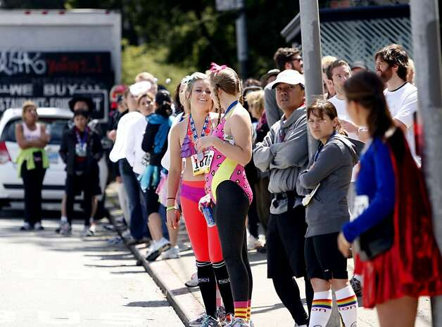 Lines of participants wait in long lines for shuttles and buses during the 100th annual Bay to Breakers 12K in San Francisco, Calif., on Sunday, May 15, 2011. Photo: Thomas Levinson, The Chronicle