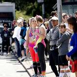 Lines of participants wait in long lines for shuttles and buses during the 100th annual Bay to Breakers 12K in San Francisco, Calif., on Sunday, May 15, 2011.