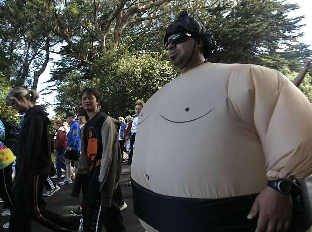 A sumo wrestler walks through Golden Gate Park during the 100th annual Bay to Breakers 12K in San Francisco, Calif., on Sunday, May 15, 2011. Photo: Thomas Levinson, The Chronicle