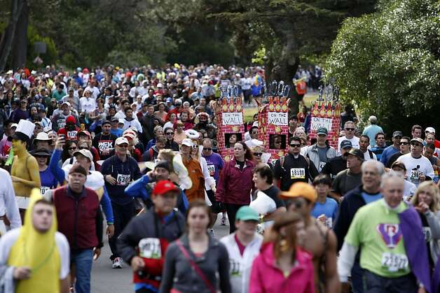Thousands of participants walk and run through Golden Gate Park towards the finish during the 100th annual Bay to Breakers 12K in San Francisco, Calif., on Sunday, May 15, 2011. Photo: Thomas Levinson, The Chronicle