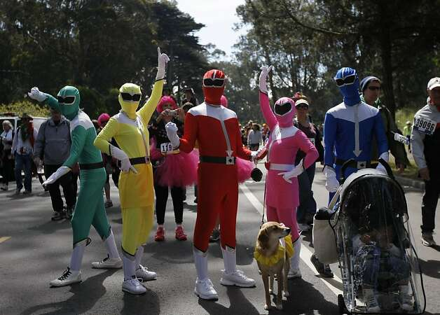 A team of Power Rangers pose for pictures during the 100th annual Bay to Breakers 12K in San Francisco, Calif., on Sunday, May 15, 2011. Photo: Thomas Levinson, The Chronicle