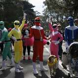 A team of Power Rangers pose for pictures during the 100th annual Bay to Breakers 12K in San Francisco, Calif., on Sunday, May 15, 2011.