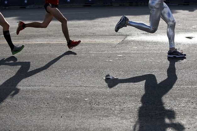 Runners stride to the finish during the 100th annual Bay to Breakers 12K in San Francisco, Calif., on Sunday, May 15, 2011. Photo: Thomas Levinson, The Chronicle