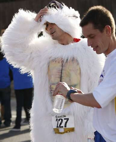 Brian Cooke of Redwood City gets some air after running in an animal suit during the 100th annual Bay to Breakers 12K in San Francisco, Calif., on Sunday, May 15, 2011. Photo: Thomas Levinson, The Chronicle